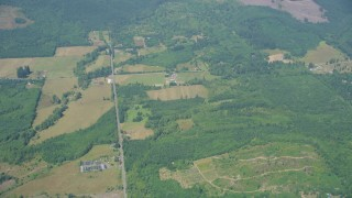AX52_013 - 5K stock footage aerial video fly away from farms in Silver Creek, Washington