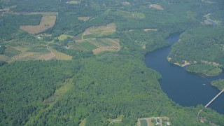 AX52_015 - 5K stock footage aerial video of reverse view of farms, fields and trees by Mayfield Lake in Silver Creek, Washington