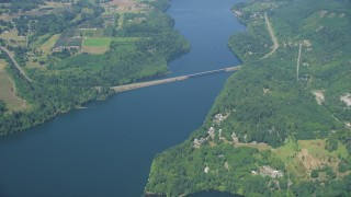 AX52_019 - 5K stock footage aerial video of reverse view of bridge spanning Mayfield Lake, and reveal lakefront homes, Washington