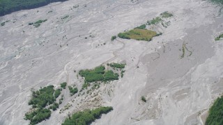 AX52_026 - 5K stock footage aerial video of reverse view of the North Fork Toutle River, full of sediment, in Washington