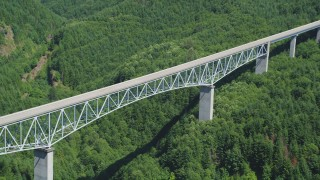 AX52_027 - 5K stock footage aerial video approach the Spirit Lake Highway bridge with forest below; Cowlitz County, Washington