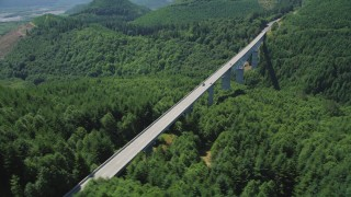 AX52_028 - 5K stock footage aerial video orbit the Spirit Lake Highway bridge and light traffic, Cowlitz County, Washington