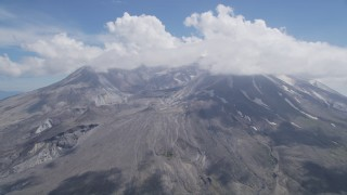 AX52_047 - 5K stock footage aerial video of Mount St. Helens crater and cloud cover, Washington