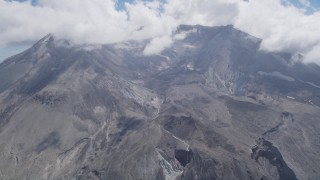 AX52_049 - 5K stock footage aerial video pass the Mount St. Helens crater with clouds, Washington