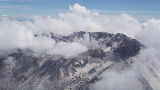 AX52_061 - 5K stock footage aerial video of Mount St. Helens crater ringed by cloud coverage, Washington
