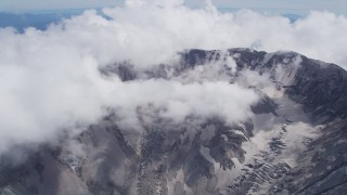 AX52_062 - 5K stock footage aerial video approach the Mount St. Helens crater with low clouds, Washington