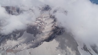 AX52_064 - 5K stock footage aerial video pan across and flyby the Mount St. Helens crater and clouds, Washington