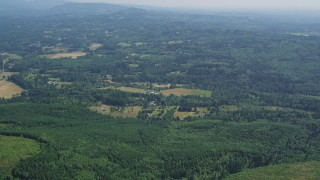 AX52_068 - 5K stock footage aerial video of small farms surrounded by evergreen forest, Amboy, Washington