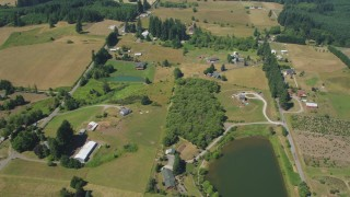 AX52_071 - 5K stock footage aerial video of small farms, fields and country roads in La Center, Washington