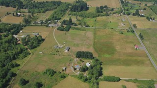 AX52_072 - 5K stock footage aerial video of country roads, farms and fields in La Center, Washington