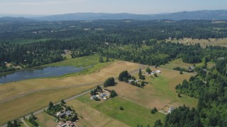 AX52_073 - 5K stock footage aerial video of farms and fields near a small pond in La Center, Washington