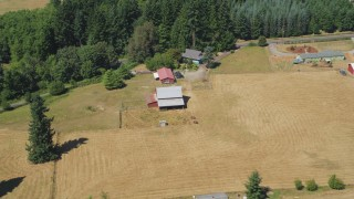 AX52_074 - 5K stock footage aerial video flyby and approach a red barn by farm fields in La Center, Washington