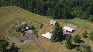 AX52_076 - 5K stock footage aerial video of a large farmhouse with red barns, La Center, Washington