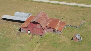 AX52_077 - 5K stock footage aerial video approach an old red barn in a farm field in La Center, Washington