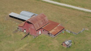 AX52_078 - 5K stock footage aerial video of old red barn in the middle of farm fields in La Center, Washington