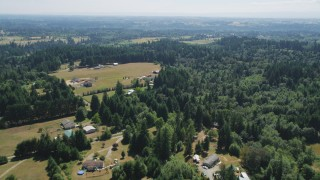 AX52_079 - 5K stock footage aerial video fly over farms, fields, and evergreen trees in La Center, Washington