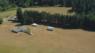 AX52_080 - 5K stock footage aerial video of small barn next to a farmhouse in La Center, Washington