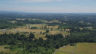 AX52_081 - 5K stock footage aerial video flyby small farms and evergreen trees in La Center, Washington