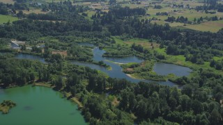 AX52_083 - 5K stock footage aerial video approach the East Fork of the Lewis River in Ridgefield, Washington