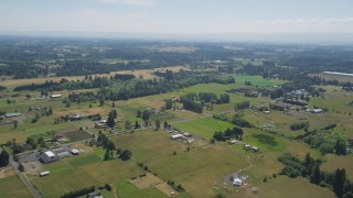 AX52_085 - 5K stock footage aerial video fly over small farms and farm fields in Ridgefield, Washington