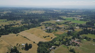 AX52_086 - 5K stock footage aerial video fly over farms with green and brown farm fields in Ridgefield, Washington