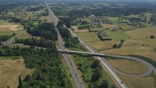 AX52_088 - 5K stock footage aerial video of light traffic on I-5 through a rural farm area in Ridgefield, Washington
