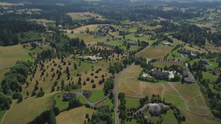 AX52_089 - 5K stock footage aerial video approach an upscale country home in Ridgefield, Washington