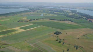 AX52_093 - 5K stock footage aerial video of wide green farm fields in Vancouver, Washington