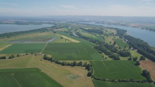 AX52_095 - 5K stock footage aerial video flyby farms and green fields near the Columbia River in Vancouver, Washington