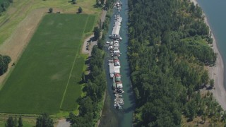 AX52_096 - 5K stock footage aerial video of bird's eye view of a row of warehouse buildings on Lake River, Vancouver, Washington