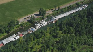AX52_097 - 5K stock footage aerial video track a row of warehouse buildings on Lake River in Vancouver, Washington