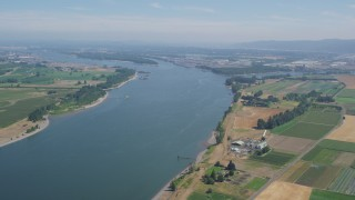 AX52_099 - 5K stock footage aerial video of Columbia River seen from farms and fields in Riverview, Oregon