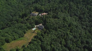 AX52_106 - 5K stock footage aerial video of three homes surrounded by forest in the Tualatin Mountains, Oregon