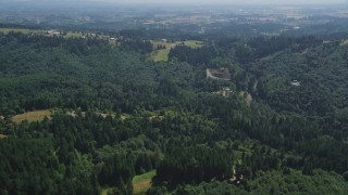 AX52_107 - 5K stock footage aerial video fly over forest and rural homes in Hillsboro, Oregon