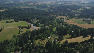 AX52_108 - 5K stock footage aerial video fly over rural homes and small farms around a country road in Hillsboro, Oregon