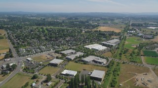AX52_113 - 5K stock footage aerial video of suburban neighborhood across the street from office buildings, Hillsboro, Oregon