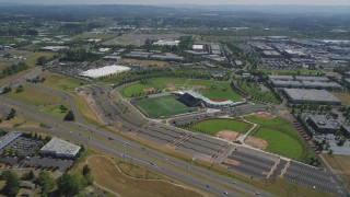 AX52_114 - 5K stock footage aerial video approach a multi-sport stadium in Hillsboro, Oregon