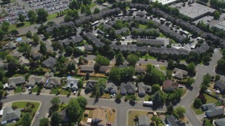 AX52_117 - 5K stock footage aerial video fly over suburban homes to approach apartment buildings in Hillsboro, Oregon
