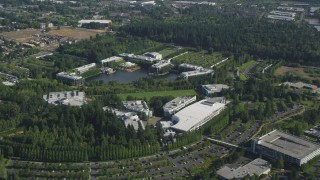 AX53_005 - 5K stock footage aerial video of Nike Headquarters beside a lake, Beaverton, Oregon