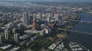 AX53_017 - 5K stock footage aerial video fly away from downtown skyscrapers and high-rises, Downtown Portland, Oregon