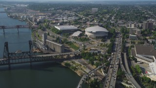 AX53_020 - 5K stock footage aerial video of approaching the Moda Center from Willamette River, Lloyd District, Northeast Portland, Oregon