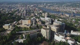 AX53_030 - 5K stock footage aerial video fly away from Oregon Health and Science University with downtown in the distance, Portland, Oregon