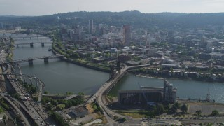 AX53_038 - 5K stock footage aerial video tilt from Moda Center revealing downtown and Willamette River, Downtown Portland, Oregon