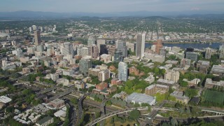 AX53_043 - 5K stock footage aerial video fly by Downtown Portland buildings and Portland State University, Oregon