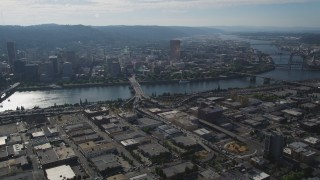 AX53_047 - 5K stock footage aerial video of Downtown Portland cityscape seen from industrial area, Portland, Oregon