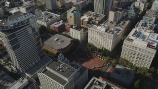 AX53_049 - 5K stock footage aerial video fly over downtown and tilt to Pioneer Courthouse Square, Downtown Portland, Oregon