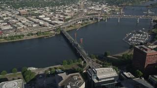 AX53_054 - 5K stock footage aerial video tilt to bird's eye view of the Steel Bridge spanning Willamette River, Downtown Portland, Oregon
