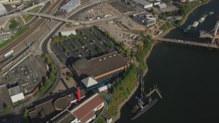AX53_055 - 5K stock footage aerial video of bird's eye of Oregon Museum of Science and Industry, Southeast Portland, Oregon