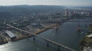 AX53_057 - 5K stock footage aerial video of orbiting Ross Island Bridge revealing cityscape, Downtown Portland, Oregon