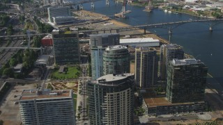 AX53_063 - 5K stock footage aerial video fly away from John Ross Tower, The Ardea and South Waterfront skyscrapers, Portland, Oregon